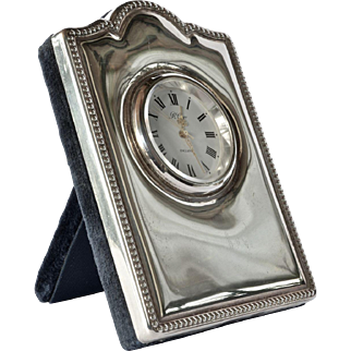 A vintage sterling silver cased small desk clock.