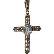 A vintage sterling silver (925) cross with a aquamarine stone, 1930c.