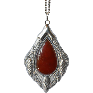 A vintage silver ( 800 standard ) pendant and chain / red stone.