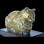 A polished bronze sculpture, 'Recumbent cat' - 1920c.