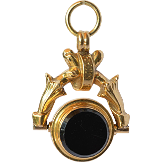 An antique 18 ct. gold and onyx swivel fob, 1890c.