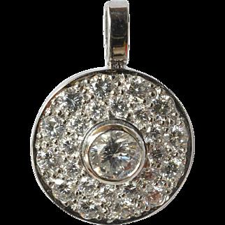Vintage, white gold (18ct. ) diamond set round pendant, 1990c.