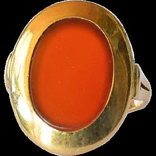 A vintage carnelian gemstone mounted 18ct. gold ring.