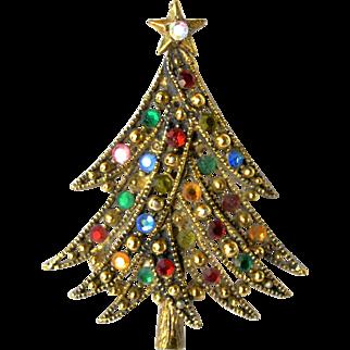 A vintage Hollycraft Xmas tree brooch.