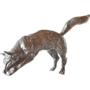 A vintage bronze patinated model of a fox.