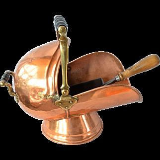 An antique copper/brass coal scuttle and shovel.