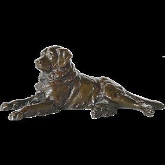 A vintage bronze plated metal Labrador reclining dog.
