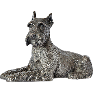 A vintage sterling silver ( 925 ) coated reclining terrier dog.
