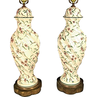 A Wonderful Pair Of Hand Painted Italian Porcelain Urn Lamps On A Brass Base