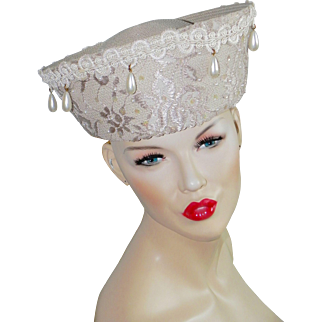 Chic vintage hat adorned with sequins and faux pearls