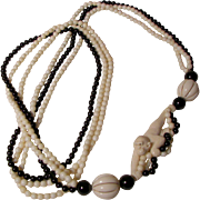 Darling Carved Monkey Necklace with Onyx Beads.  Circa 1970