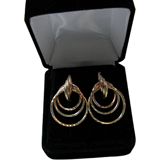 Marked 14KT Gold Triple Loop Pierced Earrings.