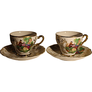 Pair of Japanese mid-century demitasse and saucer set with colorful decoration