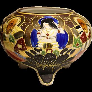 Three-legged Japanese porcelain bowl