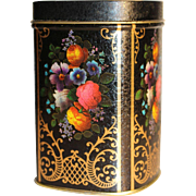 Victorian-style English tea tin with flower decoration