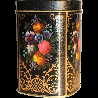 Victorian-style English tea tin with flower decoration