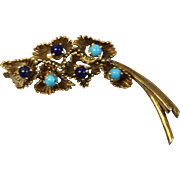 18kt Yellow Gold Flower Pin with Light and Dark Blue Stones