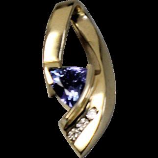 14kt Yellow Gold Pendant with Trilliant Cut Tanzanite and Three Diamonds