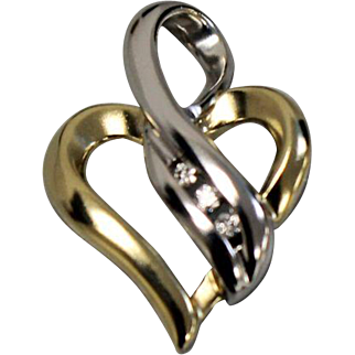 10kt Two Toned Yellow/White Gold Heart Shaped Pendant with Three Diamonds