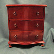 Vintage Miniature Bow Front Three Draw Chest In The Hepplewhite Style With Brass Pulls And Turned Bun Feet