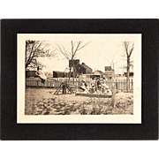 Antique Cabinet Photo of a Schoolyard Children Playing on Seesaw and in Sandbox
