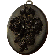 Antique Gutta Percha Civil War Era Mouring Locket done in Very High Relief Floral Motif
