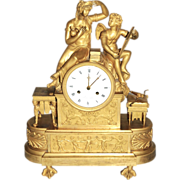 An Early 19th century French Empire Gilt Bronze Venus and Cupid Mantel Clock