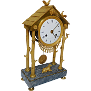 French antique Empire ormolu clock : uncommon cottage shape, early 19th century