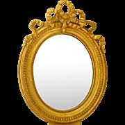 Louis XVI style oval mirror, gilt with gold leaf, mercury glass - 19th Century