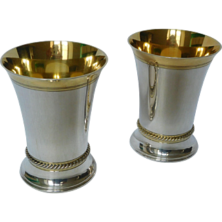 Pair of sterling silver and vermeil vases