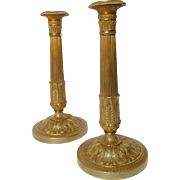 Antique French pair of Empire ormolu candlesticks, early 19th century