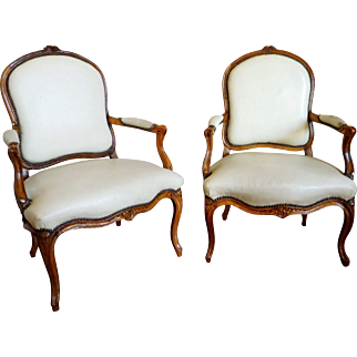 Antique French pair of Louis XV armchairs, parisian work, mid 18th century