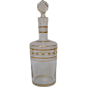 Antique French Baccarat crystal liquor decanter enhanced with fine gold