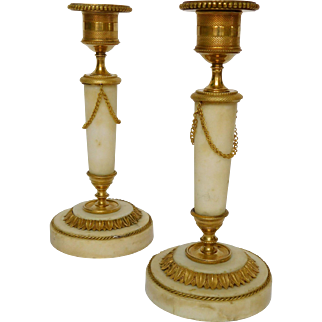 Pair of marble and ormolu candlesticks, late Louis XVI period
