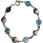 Child's Bracelet with Roses and Blue Enameled Medals