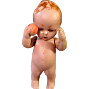 Pink All Bisque baby holding ball