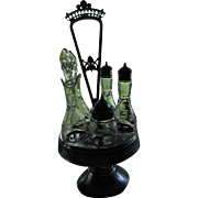 Rockford Silver Plate Castor set with 5 Matching Etched Crystal Bottles