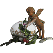 Winged Cherub on Holly Branch Holding a 4-leaf clover with Porcelain, Painted Metal Egg Shaped Sewing Thimble Holder ;Antique c1800's