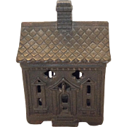 Small cast iron house still bank