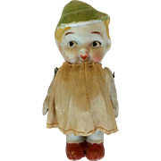 Japanese all bisque doll with green hat and red shoes