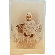 Cabinet photograph of baby with dog