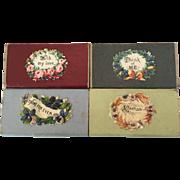 Set of four miniature antique boxes with decorative Victorian scrap labels
