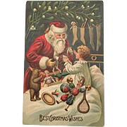 Embossed post card Santa with dolls and other toys