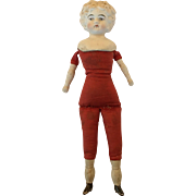 Bisque blond hair parian doll with red cloth body