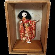 Japanese gofun doll in wooden shadow box