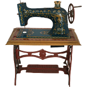 Miniature lithographed tin sewing machine
