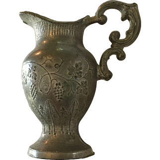 Miniature pewter doll pitcher with raised pattern of grapes