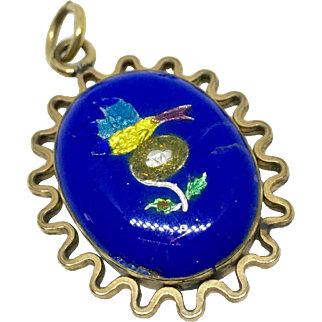 Double sided foiled enamel pendant with bird and nest