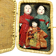 Miniature Japanese gofun doll family in basket