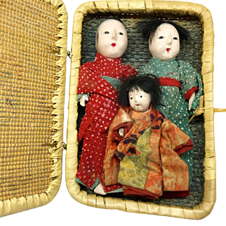 Miniature Japanese gofun doll family in basket